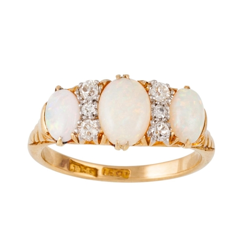 303 - A VICTORIAN OPAL AND DIAMOND CARVED DRESS RING, with opals of approx 1.00ct and diamonds of approx 0...