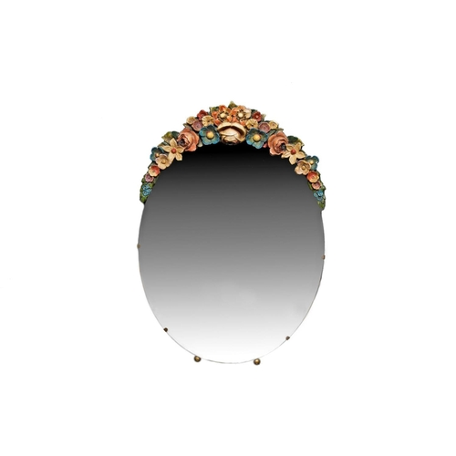 316 - A MODERN 20TH CENTURY OVAL WALL DRESSING TABLE MIRROR surmounted with a garland of flowers....