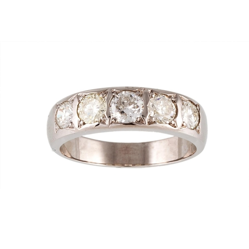 34 - A FIVE STONE DIAMOND RING, the brilliant cut diamonds mounted in 18ct white gold. Estimated; weight ...