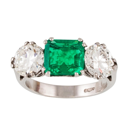 340 - AN EMERALD AND DIAMOND THREE STONE RING, the octagonal cut emerald of 2.01 ct with gem report, and d...