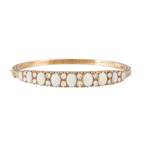 350 - AN OPAL AND DIAMOND HINGED BANGLE, with diamonds of approx 1.30ct, mounted in 9ct yellow gold, 15.4 ...