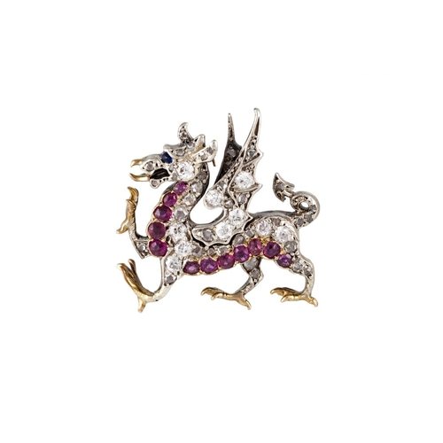 369 - A RUBY SAPPHIRE AND DIAMOND DRAGON BROOCH, in silver topped rose gold, 6.2 grams....