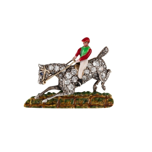 370 - AN EARLY 20TH CENTURY HORSE AND JOCKEY BROOCH, with diamonds of approx 0.70 ct, boxed....