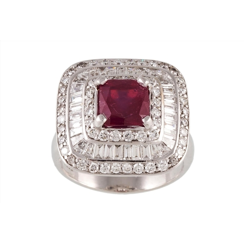 4 - A RUBY AND DIAMOND CLUSTER RING, the trap cut ruby to a baguette and brilliant diamond surround, mou...