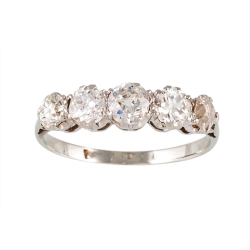 42 - A FIVE STONE DIAMOND RING, set with old cut diamonds, mounted in platinum. Estimated; weight of diam...