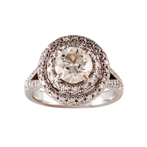 443 - A DIAMOND DOUBLE HALO RING, with centre diamond of approx. 1.63 ct Size; J/K...