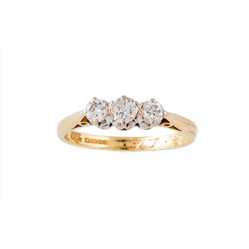 445 - A THREE STONE DIAMOND RING, of approx. 0.42ct in total, mounted in 18ct gold. Size; J...
