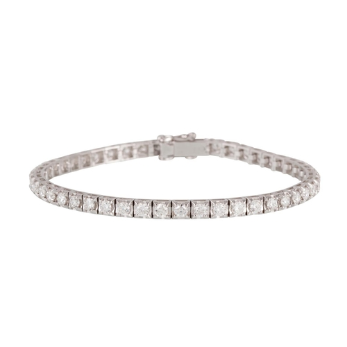 49 - A DIAMOND LINE BRACELET, the brilliant cut diamonds mounted in 18ct white gold. Estimated; weight of...