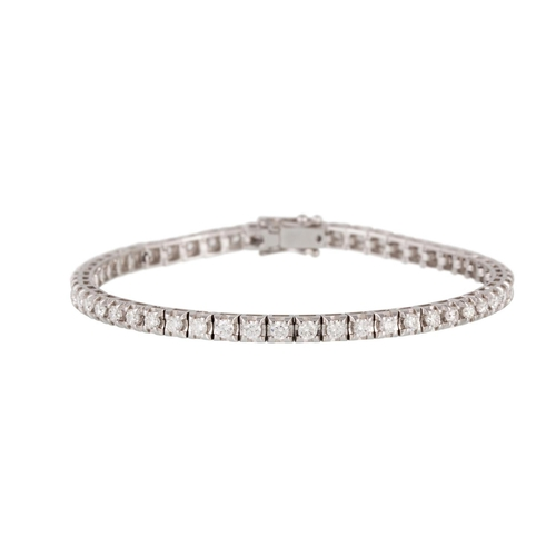 50 - A DIAMOND LINE BRACELET, the brilliant cut diamonds mounted in 18ct white gold. Estimated; weight of...