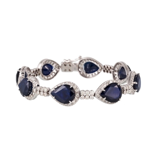 51 - A DIAMOND AND SAPPHIRE CLUSTER BRACELET, the pear shaped sapphires to brilliant cut diamond surround...