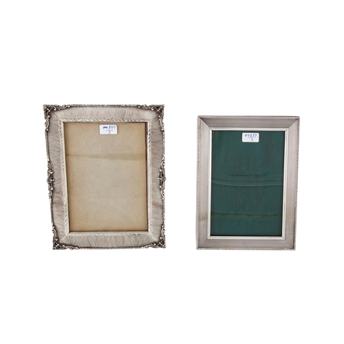 511 - A VINTAGE ITALIAN 0.800 SILVER PHOTO FRAME, together with a modern Italian 0.800 silver photo frame....