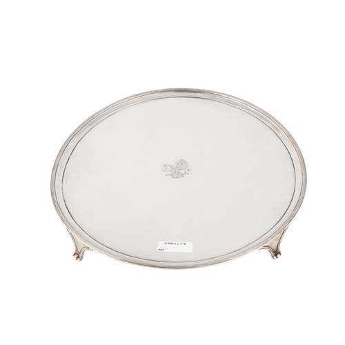529 - A GEORGE III SILVER CIRCULAR TRAY, moulded and reeded rim, engraved with The Bennett Family Crest, L...
