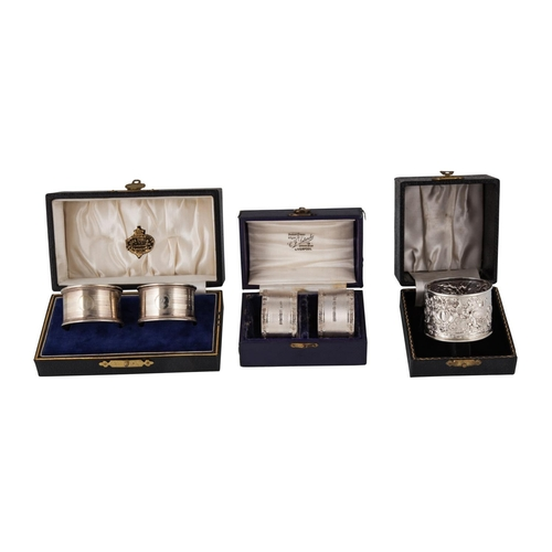 549 - THREE VARIOUS CASED SETS OF SILVER HALLMARKED NAPKIN RINGS, various dates and makers (5)...