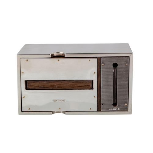 556 - AN UNUSUAL SILVER DESKTOP DISPENSING CIGARETTE BOX, with built in vesta dispenser, of plain rectangu...