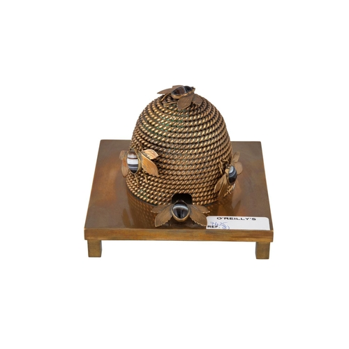 575 - A LATE 19th CENTURY BRASS INKWELL, in the form of a wicker beehive with applied semi-precious stone ...