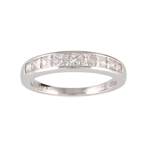 58 - A DIAMOND HALF ETERNITY RING, set with princess cut diamonds, mounted in 18ct white gold. Estimated;...