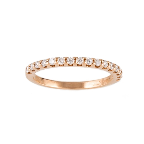 63 - A DIAMOND HALF ETERNITY RING, the brilliant cut diamonds mounted in 18ct gold. Estimated; weight of ...