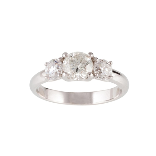 69 - A THREE STONE DIAMOND RING, the brilliant cut diamonds mounted in 18ct white gold. Estimated; weight...