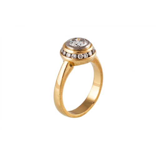 109 - A DIAMOND CLUSTER RING, the round brilliant cut diamond to a diamond surround, mounted in 18 ct yell...