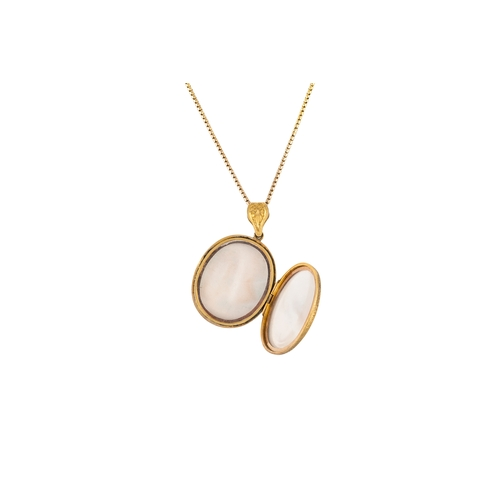 277 - A YELLOW GOLD OVAL LOCKET AND CHAIN, weight 26 grams....