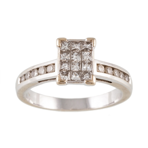 290 - A DIAMOND CLUSTER RING with diamond shoulders, mounted in 18ct white gold, size N....