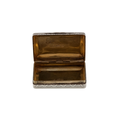 553 - A GEORGE III SILVER PILL BOX, with gilded interior, chaised and engraved outer decoration, Birmingha...