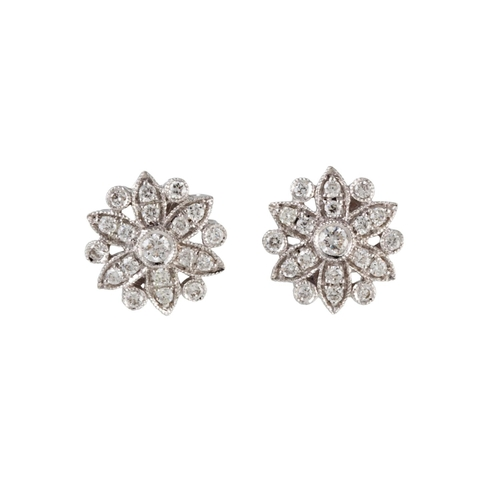 11 - A PAIR OF DIAMOND CLUSTER EARRINGS, mounted in white gold. Estimated; weight of diamonds; 0.40 ct, c...