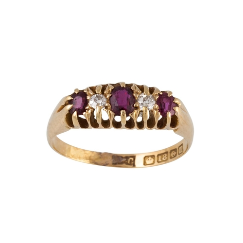 12 - AN ANTIQUE RUBY AND DIAMOND DRESS RING, in carved 18ct gold mount, boxed...