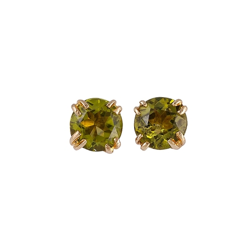 15 - A PAIR OF PERIDOT STUD EARRINGS, mounted in gold...