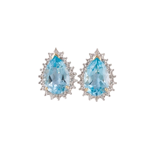 24 - A PAIR OF TOPAZ AND DIAMOND EARRINGS, of teardrop cluster form, mounted in gold...