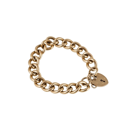 28 - A HEAVY 9CT GOLD CURB LINK BRACELET, with padlock clasp, 82 g...