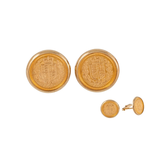 31 - A PAIR OF 9CT GOLD CUFFLINKS, set with gold half sovereigns (Royal Mint), 16 g...