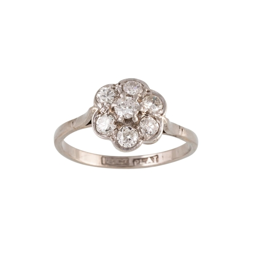34 - A DIAMOND CLUSTER RING, the circular diamonds mounted in 18ct gold. Estimated; weight of diamonds; 0...