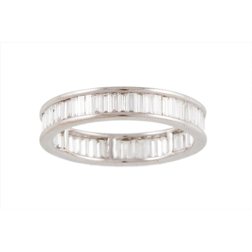 36 - A FULL BANDED DIAMOND ETERNITY RING, set with baguette cut diamonds, mounted in white gold, size N...
