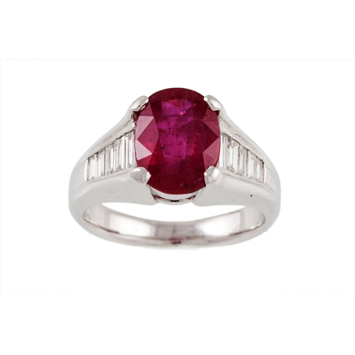 38 - A RUBY SINGLE STONE RING, to tapered baguette diamond shoulders, mounted in platinum. Estimated; wei...