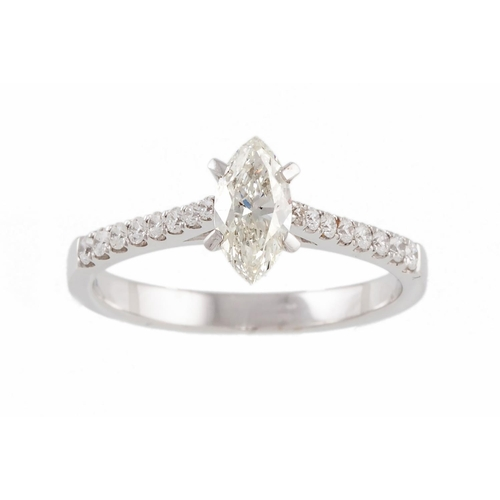 40 - A DIAMOND SOLITAIRE RING, the marquise cut diamond to diamond shoulders, mounted in 18ct white gold....