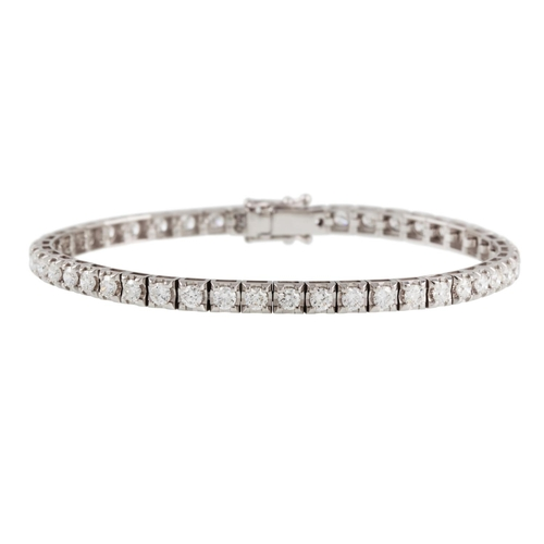45 - A DIAMOND LINE BRACELET, the brilliant cut diamonds mounted in white gold. Estimated; weight of diam...
