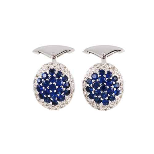 46 - A PAIR OF SAPPHIRE AND DIAMOND CUFFLINKS, pavé set in 18ct white gold...