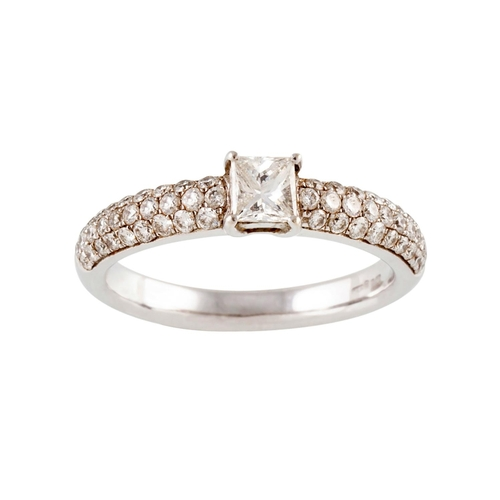 58 - A DIAMOND SOLITAIRE RING, the princess cut diamond with pavé shoulders. Estimated weight of diamond:...