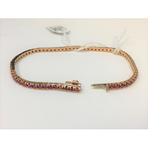 47 - A RUBY SET LINE BRACELET, the rubies set in yellow gold. Estimated; weight of rubies; 3.35 ct...