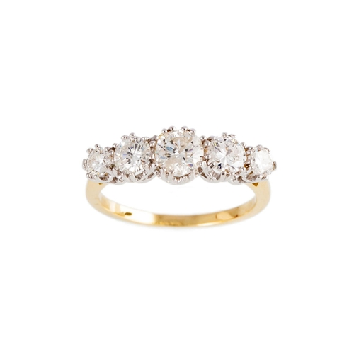 12 - A FIVE STONE DIAMOND RING, the graduating brilliant cut diamonds mounted in 18ct yellow gold and pla...