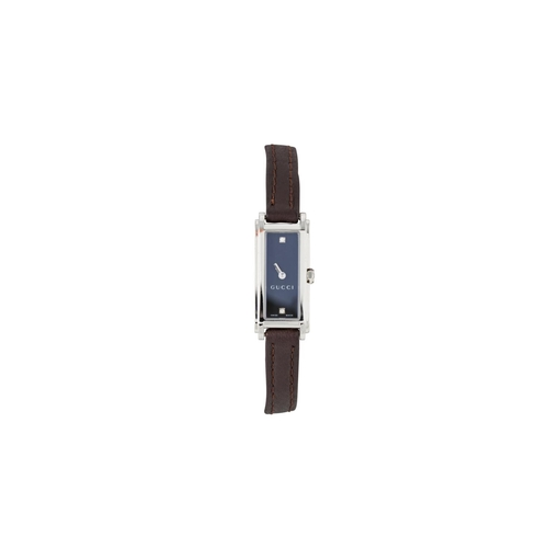 16 - A LADY'S STAINLESS STEEL GUCCI WRIST WATCH, rectangular face, diamond dot dial, replacement leather ...