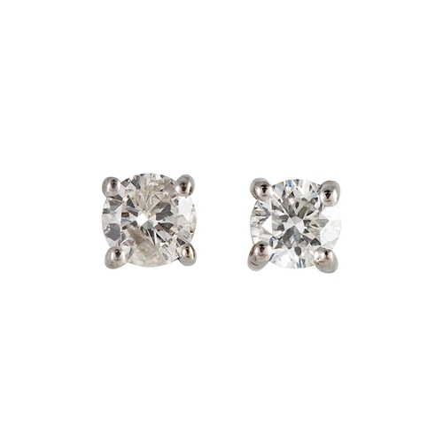 19 - A PAIR OF DIAMOND STUD EARRINGS, the brilliant cut diamonds mounted in white gold. Estimated; weight...
