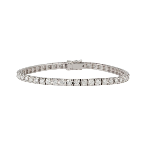 27 - A DIAMOND LINE BRACELET, the brilliant cut diamonds mounted in 18ct white gold. Estimated; weight of...