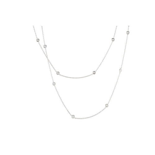 34 - A DIAMOND SET CHAIN, the brilliant cut diamonds collet set between white gold chain links. Estimated...