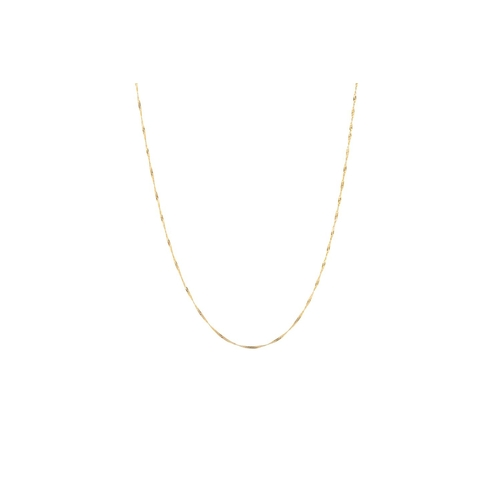 35 - A YELLOW GOLD TRACE LINK CHAIN, 22''...