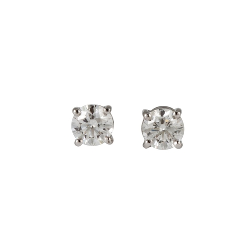 38 - A PAIR OF DIAMOND STUD EARRINGS, the brilliant cut diamonds mounted in 18ct white gold. Estimated; w...