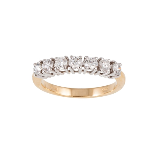 39 - A SEVEN STONE DIAMOND RING, the brilliant cut diamonds mounted in white and yellow gold. Estimated; ...