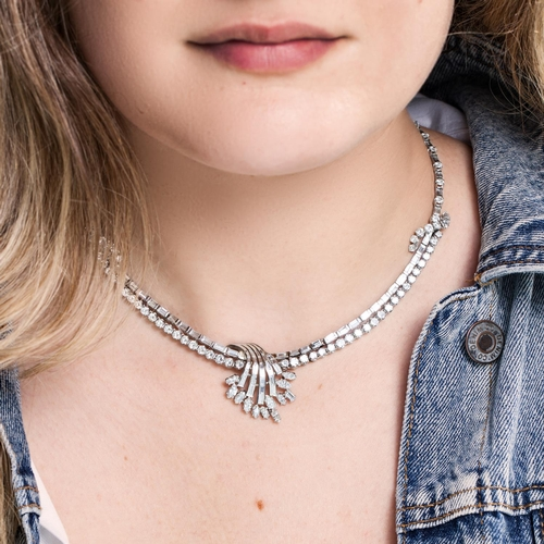 40 - A MID 20TH CENTURY DIAMOND COCKTAIL NECKLACE, set with two rows of brilliant and baguette cut diamon...