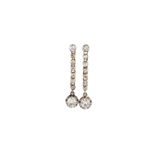 48 - A PAIR OF DIAMOND DROP EARRINGS, each comprising a line of collet set diamonds, suspending a further...